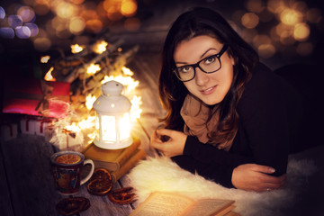 girl reading a book at home on christmas