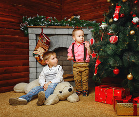 Brothers near Christmas tree