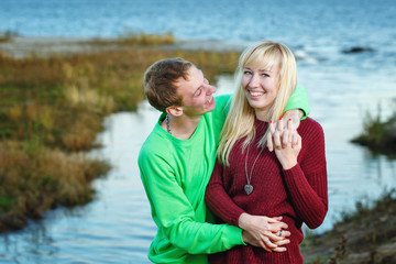 Young couple on banks of river