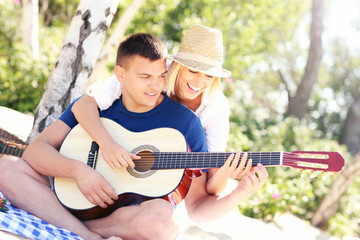 Joyful couple and guitar