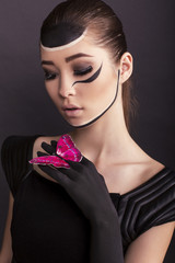 fashion photo of beautiful asian girl with painted face