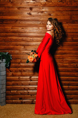 Girl in red dress with flowers