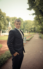 Portrait of the groom in park