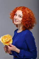 Red-haired girl and flowers