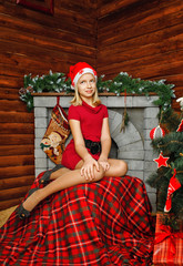Teenager girl near Christmas tree
