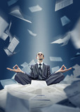 Businessman is meditating with documents