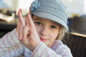 Cute girl showing horn signs