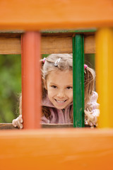 Little girl on children's playground.