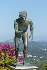 A statue of 'The Runner' in the garden of Achilleion, Corfu