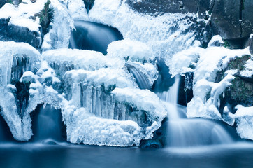 Half frozen waterfall in winter season