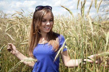 Girl among field of grain