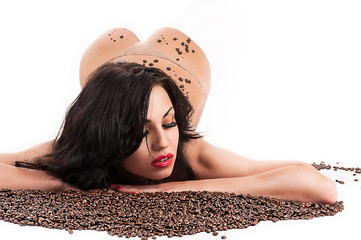 beautiful sexy woman lying with coffee beans