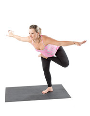 Pregnant fitness woman make stretch on yoga pose