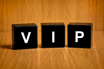 VIP or very important person word on black block