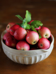 Red apples harvest in a white bowl