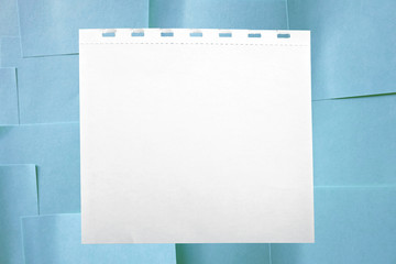 white sheet of paper on a blue memo background