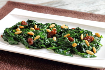 Sauteed spinach with raisins and pine nuts
