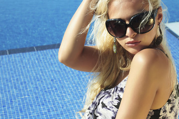 beautiful blond woman in sunglasses.summer girl.swimming pool