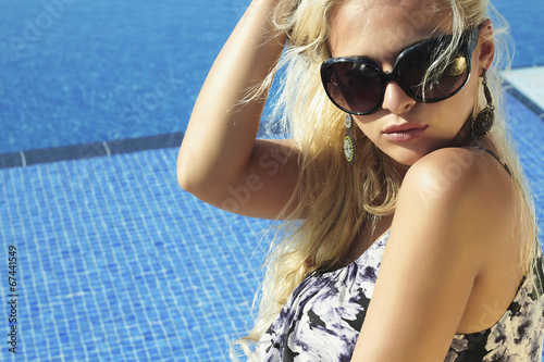 beautiful blond woman in sunglasses.summer girl.swimming pool