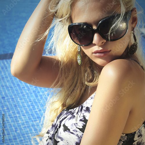 beautiful woman in sunglasses.girl near the swimming pool