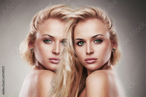 art portrait of young beautiful woman.Sexy.two girls effect