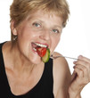 woman (67 years old) eating vegetables