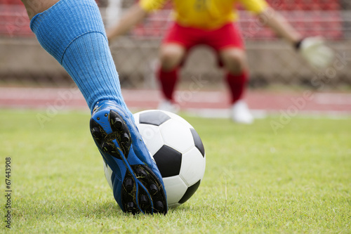 canvas print picture soccer player running with ball