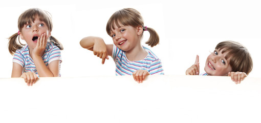 happy little girl with white blank with empty space for text