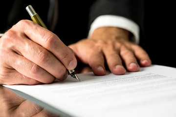 Man signing a typed document
