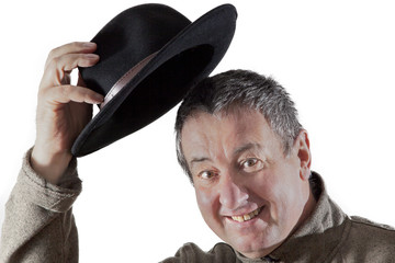 Man lifts hat in greeting