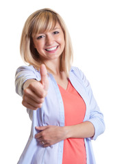 Attractive woman with dark eyes showing thumb up