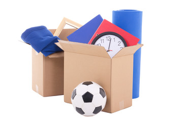 moving day concept - cardboard boxes with stuff isolated on whit