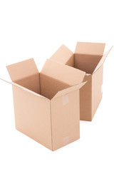 two open brown corrugated cardboard boxes over white