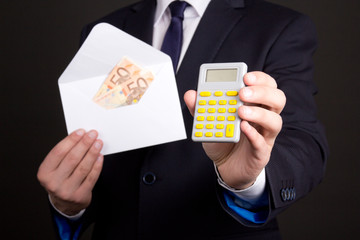 envelope with money and calculator in business man hands