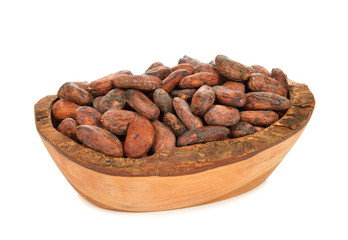 Cocoa beans in a wooden bowl