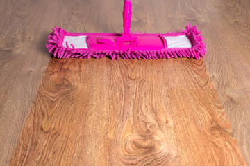 close up of wooden floor with pink mop - before after