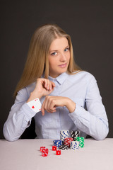 beautiful blond woman with playing card hidden under sleeve