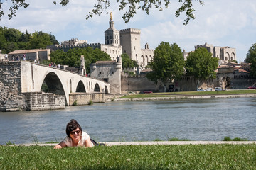 Woman against the backdrop of Avignon