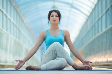 Woman doing meditating yoga exercises