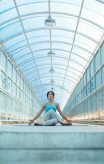 Woman doing meditating yoga exercises