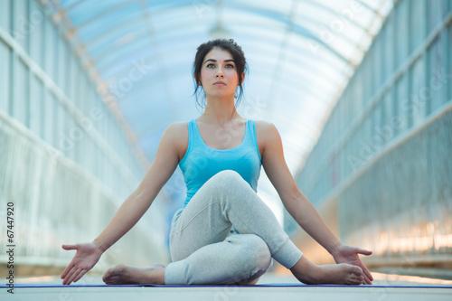 Woman doing meditating yoga exercises - 67447920