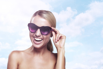 happy woman in sunglasses