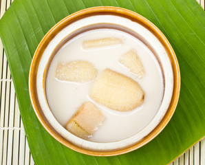 Banana in coconut milk on banana leaves,Thai desert
