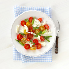 Mozzarella with red and yellow cherry tomatoes