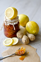 Can of citrus jam with ginger
