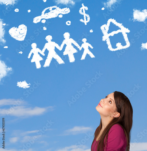 canvas print picture Young girl daydreaming with family and household clouds