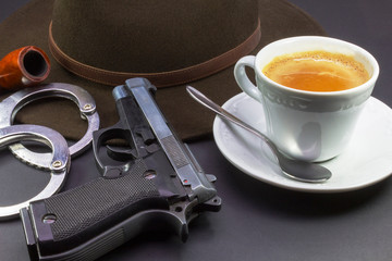 coffee detective, hat pipe gun and handcuffs