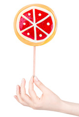Bright colorful lollipop with hand