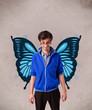 Handsome young man with butterfly blue illustration on the back