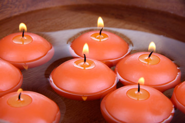Beautiful candles in water close-up